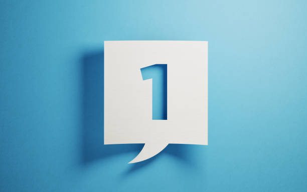 White chat bubble on  blue background. Number one writes on chat bubble. Horizontal composition with copy space.